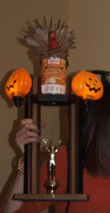 Trophy close-up. Note Elissas fingers tightly wrapped around the prize.