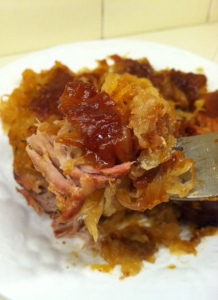 A delicious bite of fork-tender pork and sauerkraut.