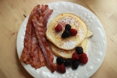 Lemon ricotta pancakes and bacon.