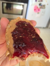 Toast with peanut butter and fresh blackberry jam.