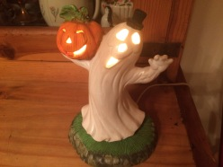 Ghostie Ghost, he was painted by Larry Fine, (of Three Stooges fame's) niece. I got him at a craft fair years ago. I love him. Halloween doesn't officially start until we light his light.