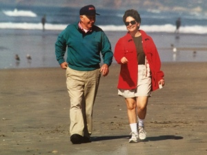 My Dad, in his favorite sweatshirt, with me walking on the beach years ago.