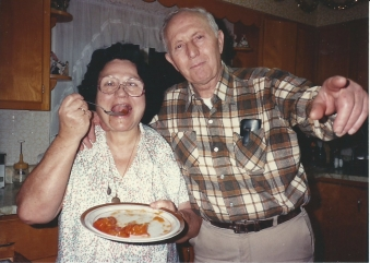 Mom and Dad with persimmons